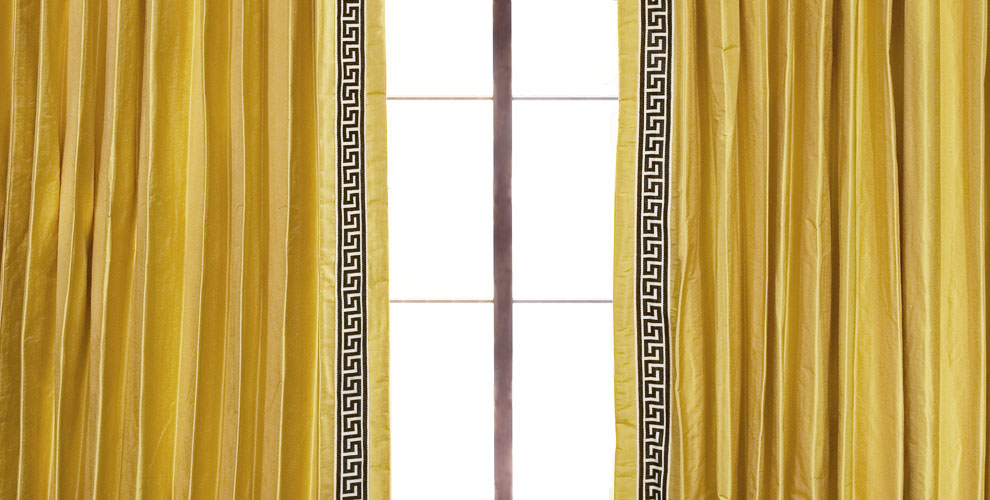 Shown: Golden Dupioni with Ebony Greek Key Trim, Parisian Pleat